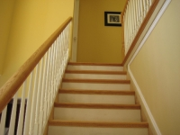 Staircase Remodeled with Butterscotch Oak Treads in New York